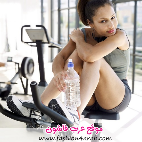 Young Woman Exercising on an Exercise Bike