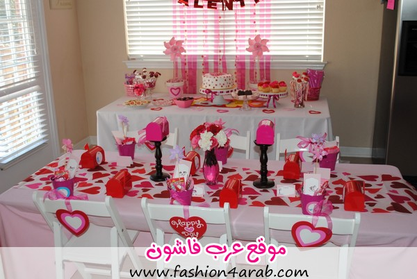 Valentines-Table-Decoration-with-Love-Patterned-Tablecloth-and-Various-Tasty-Cakes-also-Red-and-Pink-Mail-Box-and-Glass-Vase-and-Mini-Pink-Pots