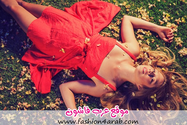 Beautiful-Young-Woman-Lying-on-Grass-with-Flowers