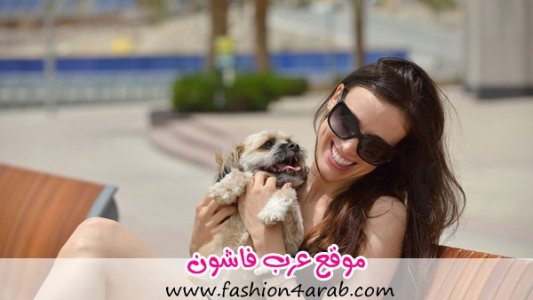beautiful-happy-young-woman-in-black-dress-with-cute-small-dog-puppy-have-fun-on-street-