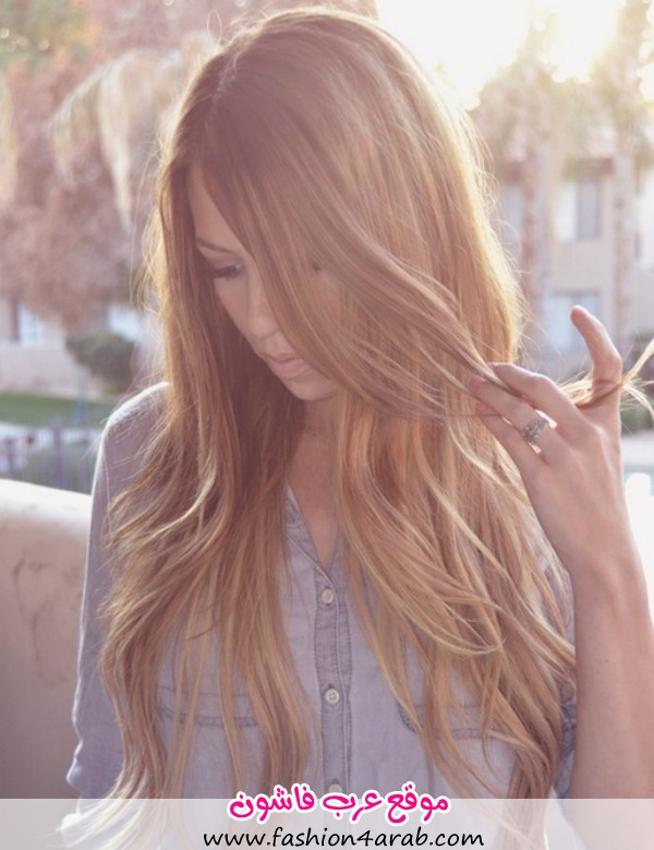 Girl-in-a-denim-shirt-with-brown-blonde-wavy-hair