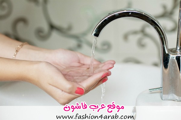 girl-holding-hands-with-red-nails-under-tap-of-water