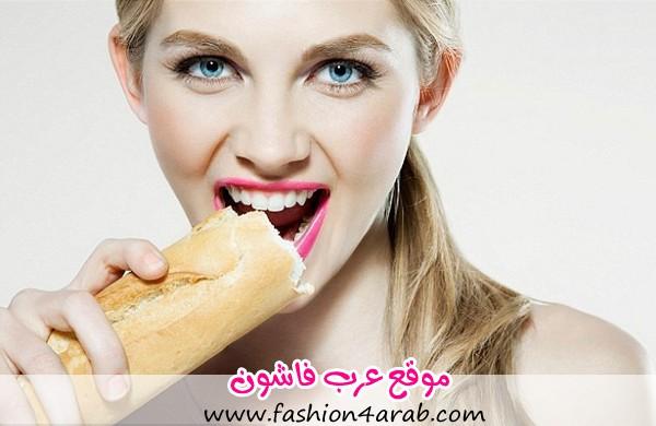 1409761322786_wps_1_Young_woman_biting_baguet